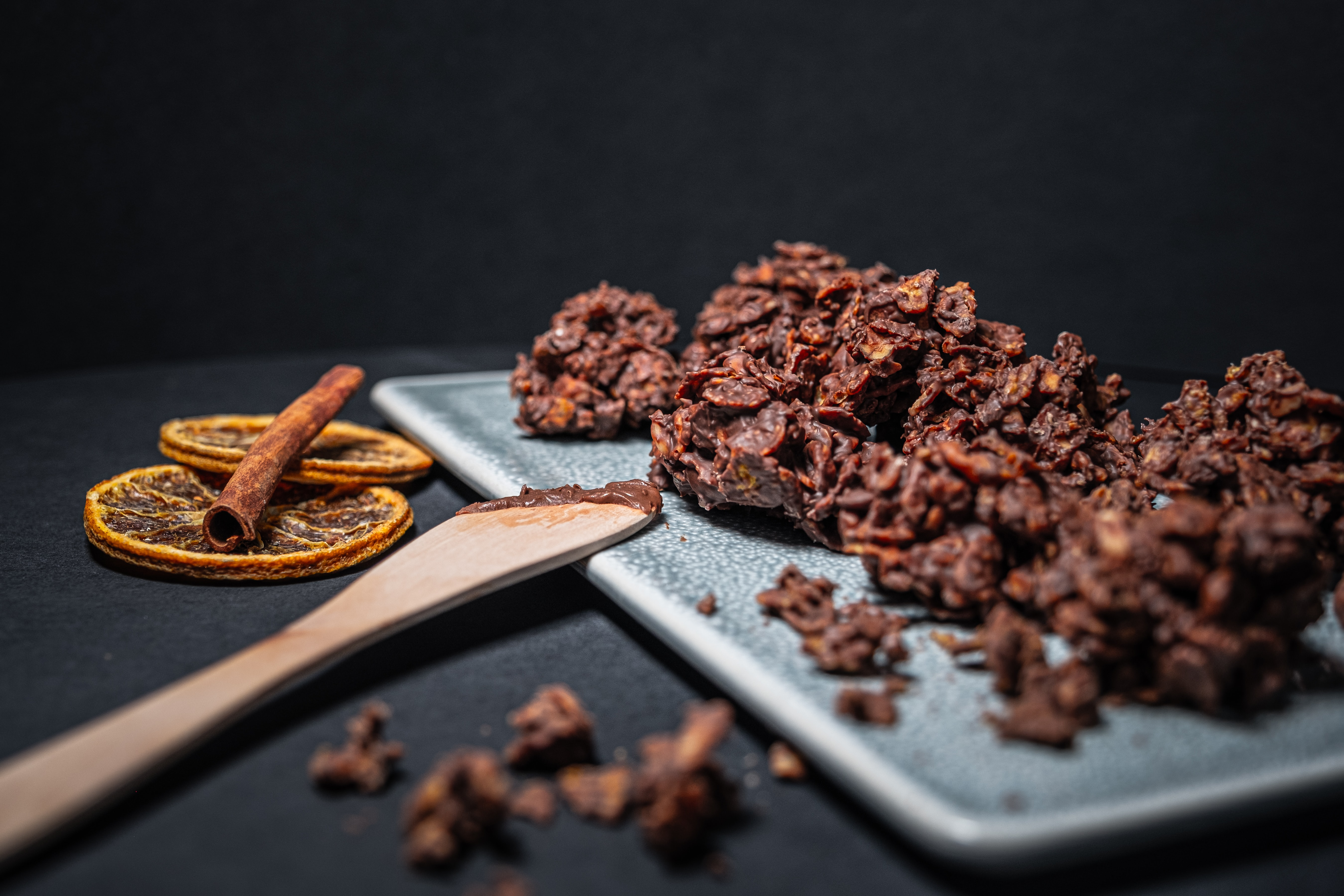 mixed nuts covered in chocolate as a healthy halloween candy alternative